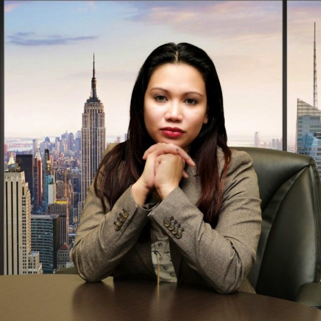 cover letter template. Asian woman sitting at a desk in front of city skyline