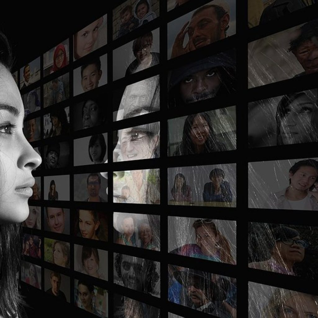 Facebook profile picture. Image of woman reflected in a mirror made of profile pictures.