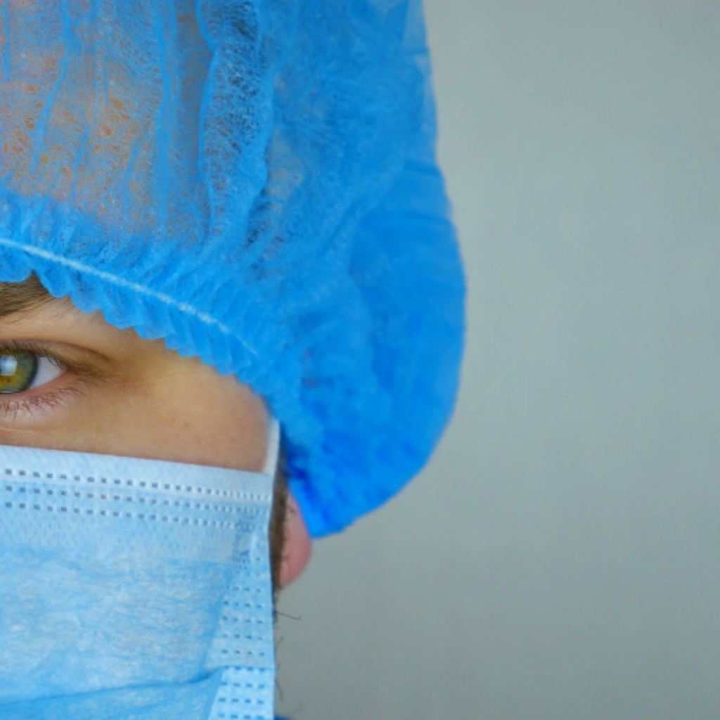 nursing. Picture of a male nurse with a face mask and hair net.
