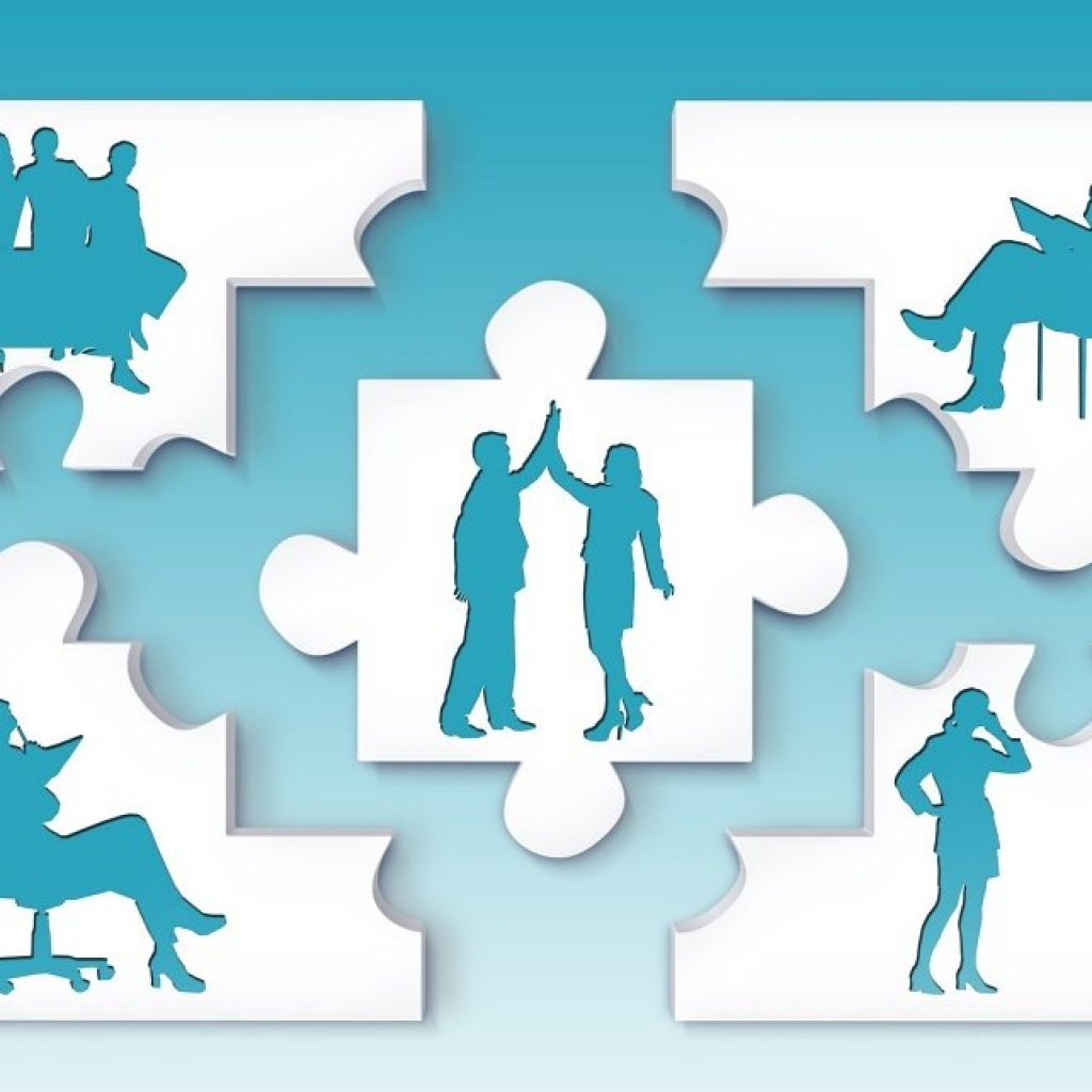 Demonstrate Leadership in an interview. puzzle pieces with shadows of different people in business poses